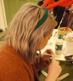 Volunteer helping with Christmas crafts